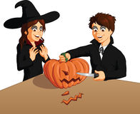 Vector illustration of boy and girl carving pumpkin Royalty Free Stock Photography