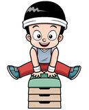 A Boy jumping gymnastic buck Royalty Free Stock Images