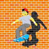 Skater boy doing trick Royalty Free Stock Photo