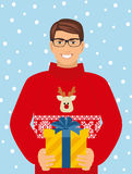 Vector illustration of a boy in a sweater with a deer holding a gift Royalty Free Stock Images