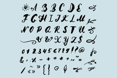 Vector Illustration brush style of calligraphy alphabet. Lowercase letters and numbers Stock Image