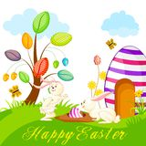 Bunny hidding Easter Egg Stock Images