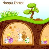 Bunny painting Happy Easter in Burrow Royalty Free Stock Image