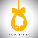 Vector illustration card of Hanging easter orange egg with bow and silhouette of newborn chicken Stock Photos
