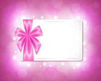 Card with a pink ribbon Stock Images