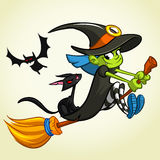 Vector illustration of cartoon girl dressed in a witch costume for Halloween and riding a broomstick Royalty Free Stock Image