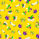 Vector illustration of cartoon seamless pattern with carnival party colored mask stock photos