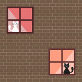 Vector illustration of a cats in house windows Stock Image