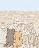 Couple of city cats sit on the rooftop. Vector illustration of the cats sitting on the roof of a house Royalty Free Stock Image