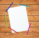 Notebook sheet surrounded with colored pencils on wood table background. Vector illustration of clear checkered notebook sheet surrounded with colored pencils on royalty free stock photo