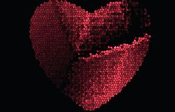 Chopped, broken red heart from stained glass on a black background. For Valentines Day. stock photos