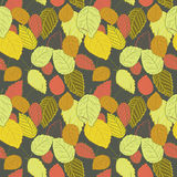 Vector illustration of colorful leaves on dark background. Hand drawn colorful leaves on dark background. Red, orange, yellow and green leaves stock illustration