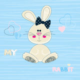 Vector illustration of a cute beige bunny girl baby in a striped blue background with hearts in pastel colors. Royalty Free Stock Images