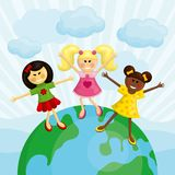 Happy multi ethnic girls standing on the earth. Royalty Free Stock Photo