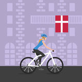 Vector illustration of cyclist girl on bike that rides through the city; biker and bicycling; sport and exercise. Flag of Denmark Stock Photography