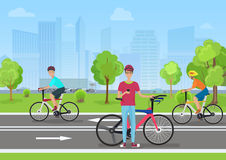 Vector illustration of cyclists in the park. Man cyclist using his phone. Cyclists walk in the Park on the modern city Stock Images