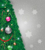 Vector illustration of decorated Christmas tree. Part of christmas tree with red silver gold and green glass balls, chains, stars, ribbon, snowflakes. at light Royalty Free Stock Images