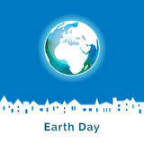 Vector illustration. Earth Day poster. Concept for celebrating of Earth Day. Houses silhouettes, town. Vector background with the globe with watercolor texture Royalty Free Illustration