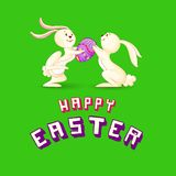 Easter Bunny presenting Colorful Egg Royalty Free Stock Photo