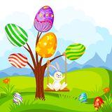 Easter Bunny swinging on Egg Tree Royalty Free Stock Images