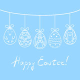 Vector illustration Easter eggs with hand drawn angel, chicken, rabbit and abstract ornaments, suspended on twine above Royalty Free Stock Photo
