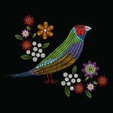 Vector illustration embroidery stitches with gouldian finch, cha. Momile wildflowers, spring flowers, branches in color. Fashion ornament on black background for Royalty Free Stock Photo