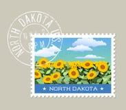 Vector illustration of field of sunflowers. North Dakota. North Dakota postage stamp design. Vector illustration of field of sunflowers. Grunge postmark on Stock Photo