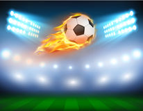 Vector illustration of a football in a fiery flame. Vector illustration of a football, soccer ball in a fiery flame on a field with the searchlights turned on Royalty Free Stock Photo