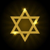 Vector illustration of golden Magen David with rays and sparkle. Star of David on a black background Stock Image
