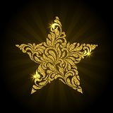 Vector illustration of golden star with rays and sparkle on a black background. Star created from abstract flower ornament vector illustration