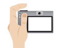 Vector illustration of a hand holding a camera. Illustration of a hand holding a camera, vector style in white background Royalty Free Stock Image