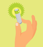 Hand holding green battery Stock Image