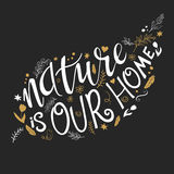 Vector illustration of hand lettering text - nature is our home. This text with decorative element is in leaf shape Stock Image