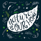 Vector illustration of hand lettering text - nature is our home. This text with decorative element is in leaf shape Stock Photo