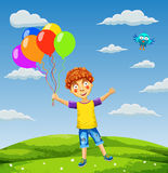 Vector illustration of a happy boy with balloons on a meadow Stock Images
