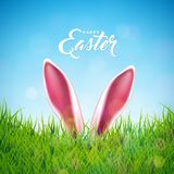 Vector Illustration of Happy Easter Holiday with Rabbit Ears, Painted Egg and Flower on Nature Grass Background Stock Photo