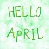 Vector illustration inscription hello april on a light green background bokeh.  Royalty Free Stock Image