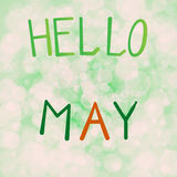 Vector illustration inscription hello may on a light green background bokeh.  Stock Images