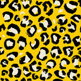 Vector illustration leopard print seamless pattern. Yellow hand drawn background. royalty free illustration