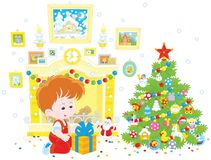 Boy with his Christmas gift. Vector illustration of a little boy sitting with his holiday gift near a fireplace and a colorfully decorated Christmas tree Royalty Free Stock Photography