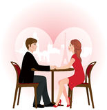 Loving couple on a date in the cafe Stock Photos