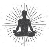 Vector illustration of a male silhouette in meditating lotus pose with scroll and sunburst on white background with dirty grunge t Royalty Free Stock Image