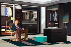 Modern Man Reading a Book at Home Royalty Free Stock Photo