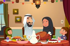 Muslim Family Eating Dinner at Home Royalty Free Stock Photo