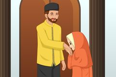 Muslim Girl Kissing Her Father Hand stock photo