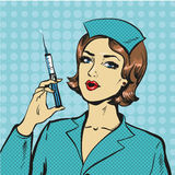 Vector illustration of nurse with syringe in pop art style Stock Photography