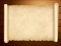 Old papyrus in the wooden background Royalty Free Stock Photography