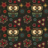 Vector illustration of owl. Bird illustrated in tribal. Owl whith. Flowers on dark background. Colored and ornamental, bright colored owl royalty free illustration