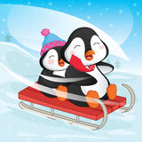 Vector Illustration Of Penguins Skiing Royalty Free Stock Images