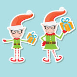 Vector Illustration of the playful Santa elves Stock Image